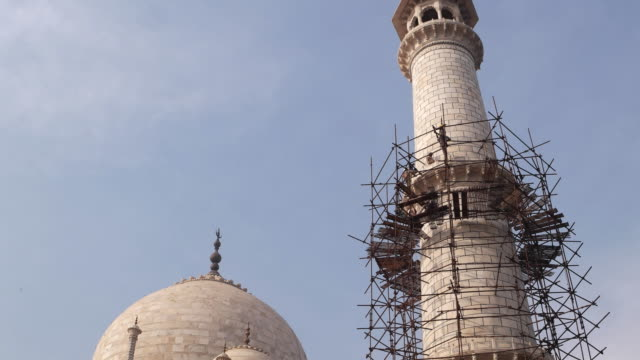 One of the grand white marble minaret of the Taj Mahal, a UNESCO world heritage site, undergoing renovation work in India