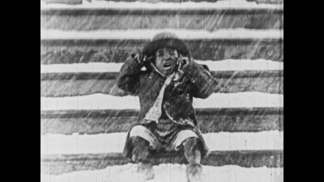1926 One of the Little Rascals gets covered by a mound of snow