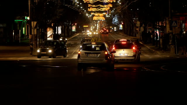 one of the main streets traffiic at night. belgrade, serbia, europe. christmas decoration lights visable - brake stock videos & royalty-free footage