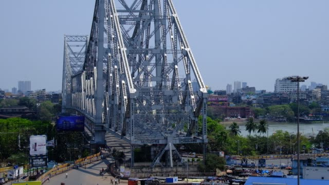one of the most busiest place howrah bridge of kolkata and howrah is empty due to coronavirus pandemic. kolkata, india, 22nd march 2020. - kolkata stock videos & royalty-free footage