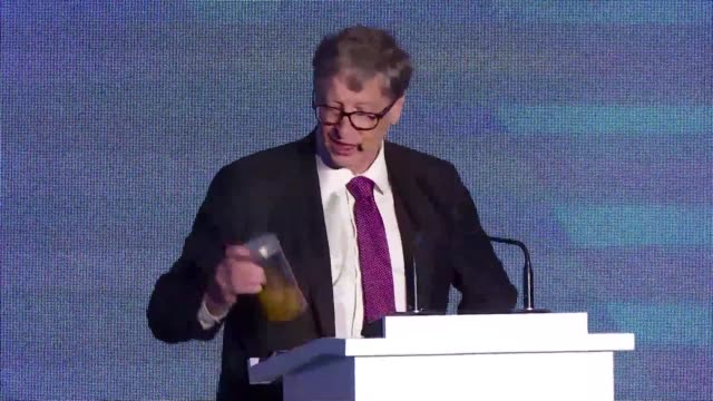 stockvideo's en b-roll-footage met one of the world's richest men and most active philanthropists founder of microsoft bill gates brandishes a jar of human waste at a forum on the... - glazen pot