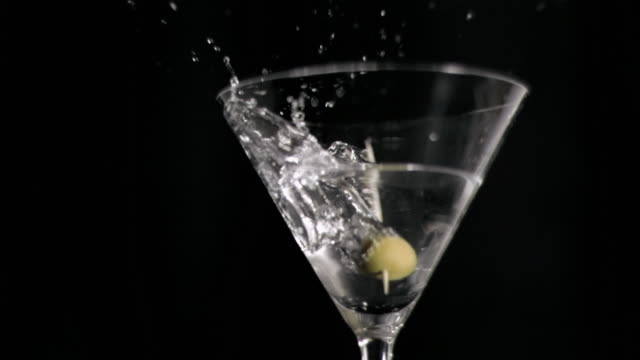 one olive falling in super slow motion in a martini - black olive stock videos & royalty-free footage