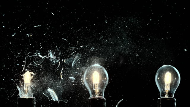 slo mo one out of three light bulbs exploding - ideas stock videos & royalty-free footage
