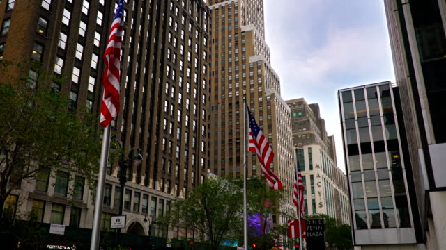 one pen plaza and ameriacan flag - 34th street stock videos and b-roll footage