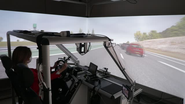 """one person experiences the cockpit of an autonomous driving simulator at the """"mobilab"""", where the transdev group autonomous transport systems team... - computer equipment stock videos & royalty-free footage"""
