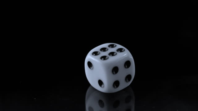 slo mo ld one playing dice rolling on black surface - dice stock videos & royalty-free footage