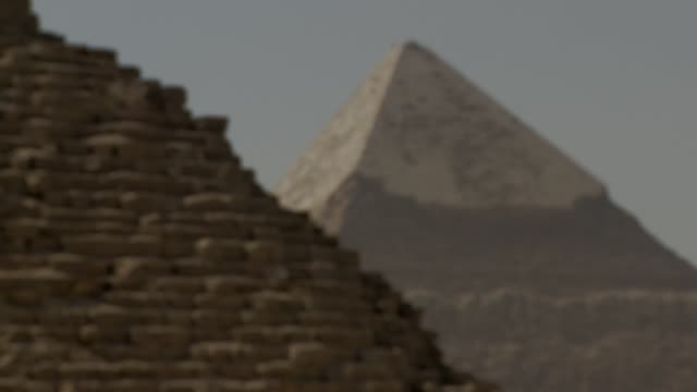 one pyramid towers behind another in the giza necropolis. available in hd. - pyramide bauwerk stock-videos und b-roll-filmmaterial