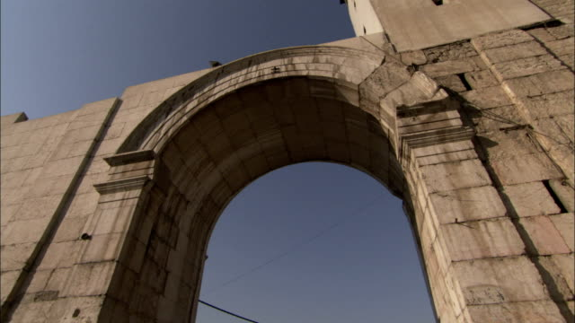 one roman arch survives in old town damascus. available in hd. - arch architectural feature stock videos and b-roll footage