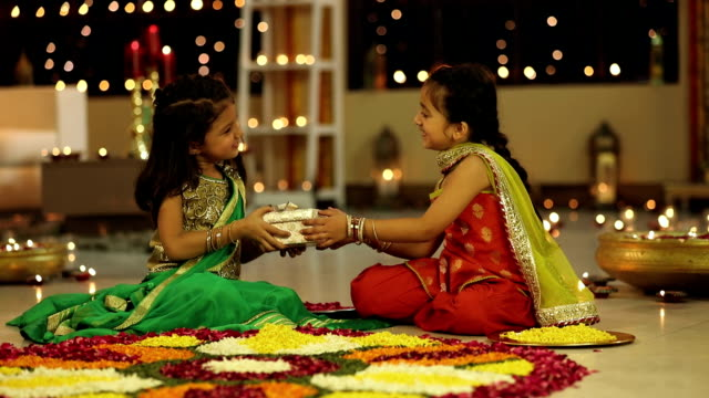 ms pan one sister giving gift to another sister during diwali festival - votive candle stock videos and b-roll footage