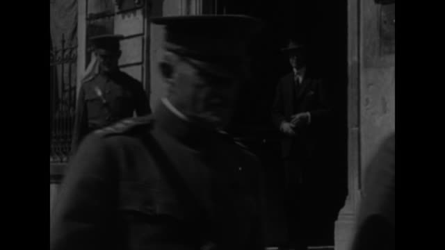 ms one soldier holds large loaf of bread while another one cuts it in half / vs american general john pershing and other officers walk out of... - general military rank stock videos and b-roll footage