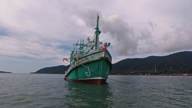 one squid fishing boat at sea, thailand - andaman sea stock videos & royalty-free footage