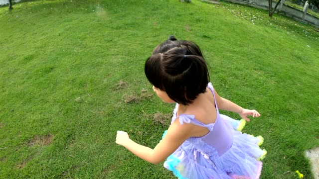 one thai child raced on the lawn with fun. - lawn stock videos & royalty-free footage