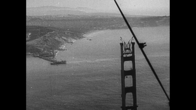 one tower of the golden gate bridge under construction with the golden gate strait in the background / note exact month/ day not known - golden gate bridge stock videos & royalty-free footage