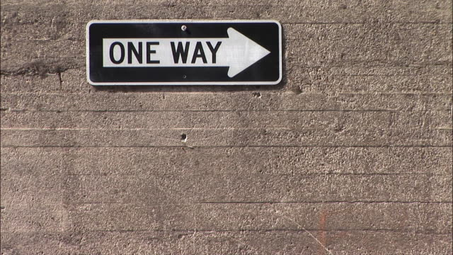 """zo,""""one way"""" sign on wall - one way stock videos & royalty-free footage"""