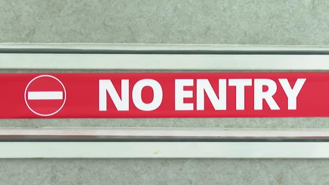 one way system signs on school staircase as schools in england prepare to reopen following coronavirus lockdown, birmingham - ウエストミッドランズ点の映像素材/bロール