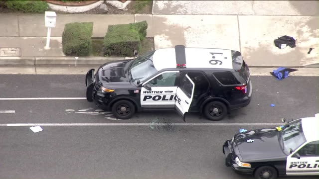 ktla one whittier police officer has died and another officer was wounded following a shootout with a suspected gang member monday morning... - gang stock videos and b-roll footage
