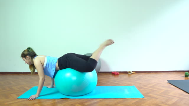 4K: One Woman Exercising with Pilates Ball