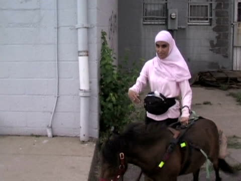 one woman in chicago has found an original way to live with her disability she is blind and says her muslim faith forbids the use of a guide dog... - dearborn michigan stock videos and b-roll footage