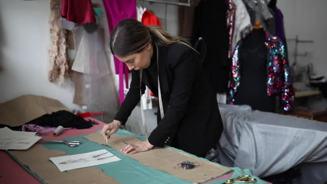 one woman working on the sewing workshop - fashion designer stock videos & royalty-free footage
