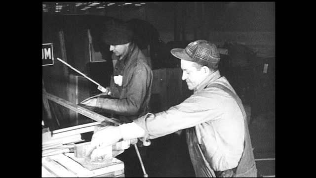 one worker oiling the machinery as the other holds up a sign and looks at the camera; two workers oiling the machinery; worker holding up a sign:... - 1940 1949 stock videos & royalty-free footage