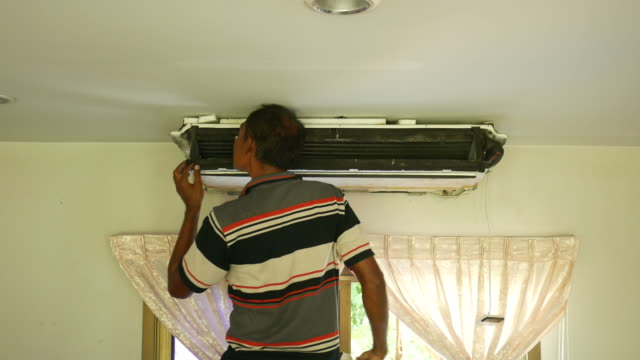 one worker repairing air conditioner - air conditioner stock videos & royalty-free footage
