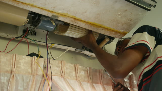 one worker repairing air conditioner