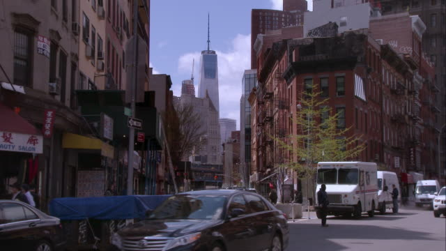 one world trade center as seen from canal street in chinatown - viewpoint stock videos & royalty-free footage
