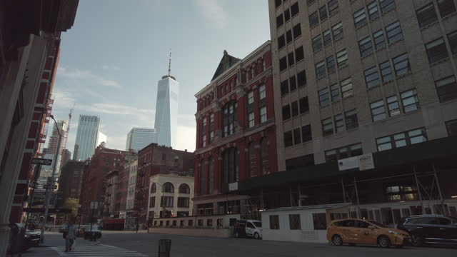 one world trade center from tribeca with a yellow taxi cab in the foreground on august 16, 2021 in new york city, new york. - yellow taxi stock videos & royalty-free footage