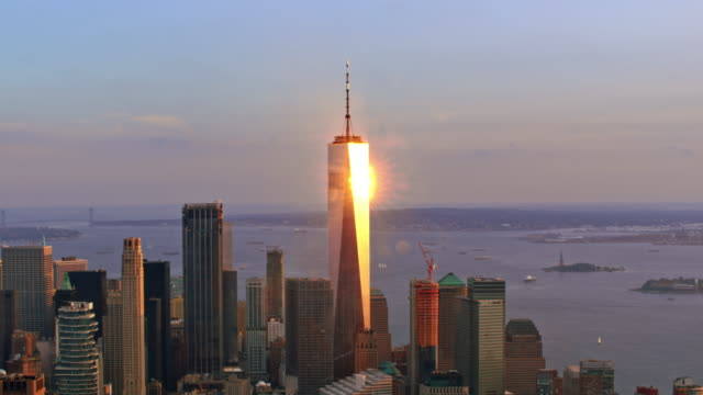 aerial one world trade center reflecting the setting sun - world trade center manhattan video stock e b–roll