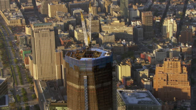 one world trade center undergoes construction in new york city. - one world trade center stock-videos und b-roll-filmmaterial