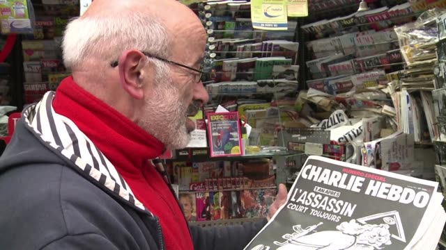 vídeos y material grabado en eventos de stock de one year after brutal terror attacks wiped out most of its staff french satirical weekly charlie hebdo published a special edition with a cover... - satírico