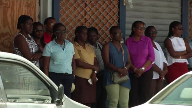 vídeos y material grabado en eventos de stock de one year after hurricane irma residents of saint martin mark a minute of silence in front of the monument to the dead of marigot in memory of the 11... - territorios franceses de ultramar