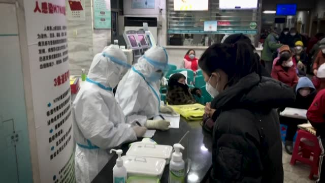 one year ago, china announced the first death from a new virus in wuhan -- 12 months later, covid-19 has claimed 1.9 million lives in an unrelenting... - epidemic stock videos & royalty-free footage