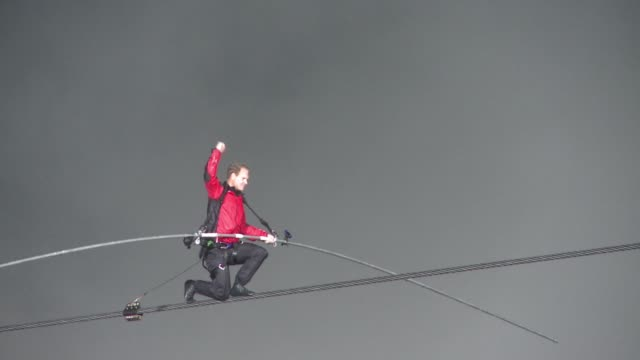 one year ago us daredevil nik wallenda crossed niagara falls on a tightrope. clean : us daredevil set for grand canyon on june 22, 2013 in niagara... - stunt person stock videos & royalty-free footage