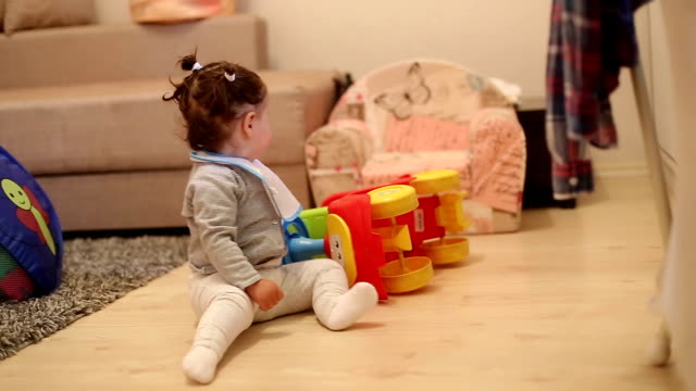 one year old baby playing with baby push car - babies only stock videos & royalty-free footage