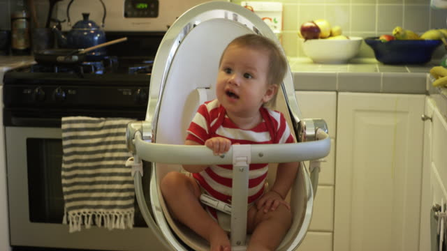 one year old baby rocking in his chair - mixed race person stock videos & royalty-free footage