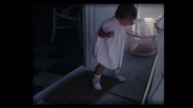 1962 one year old girl steps then falls on porch - home movie stock videos & royalty-free footage