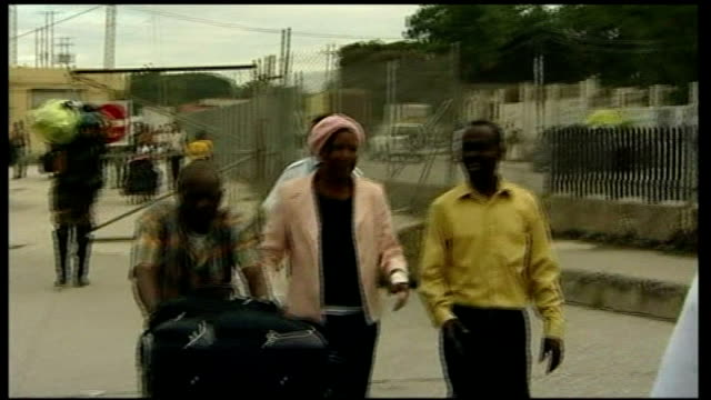 ginette sinfort story haiti port au prince ext ginette sinfort greeted by her husband roger sinfort at airport as she returns to haiti following... - hispaniola stock videos & royalty-free footage