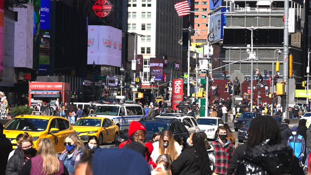 one year since the epidemic of coronavirus disease crisis in times square new york city. - yellow taxi stock videos & royalty-free footage
