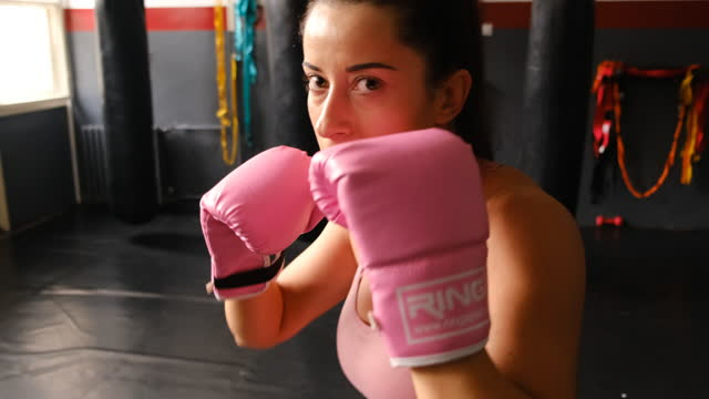 one young female boxer shadow boxing - punching stock videos & royalty-free footage
