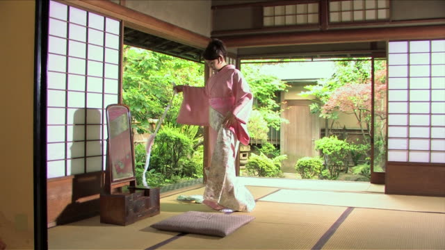 one young woman wearing kimono is undressing - screen partition stock videos and b-roll footage