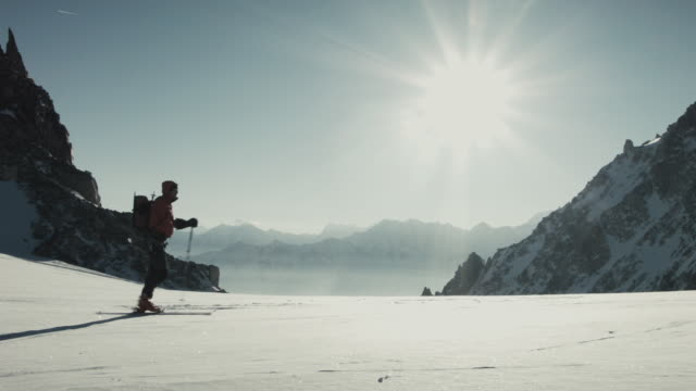 One-armed skier skiing in the mountains in Swiss Alps