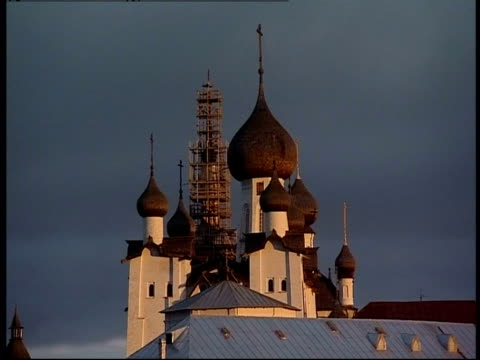 onion domes appear brown against the russian night sky. - onion dome stock videos and b-roll footage