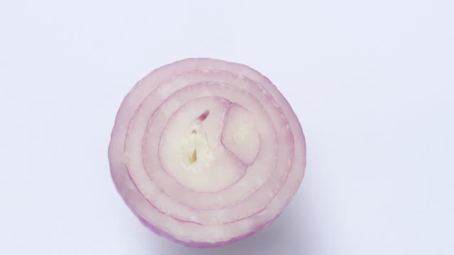 onion rotate on white background - onion stock videos & royalty-free footage