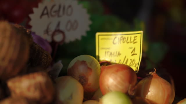 onions at italy market with price tag - onion stock videos & royalty-free footage