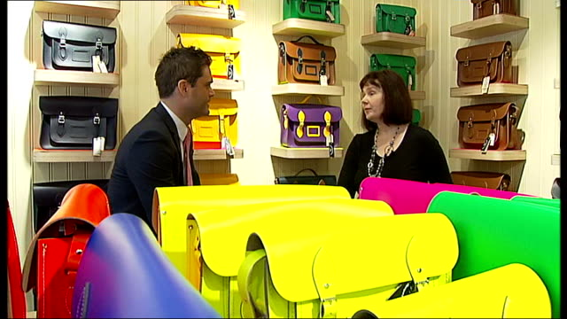 online company 'cambridge satchel company' opens first shop reporter chatting to deane surrounded by satchel bags - satchel stock videos & royalty-free footage