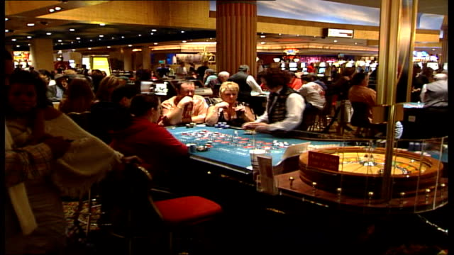 usa online gambling ban date people seated at roulette table in casino - online casino stock videos & royalty-free footage