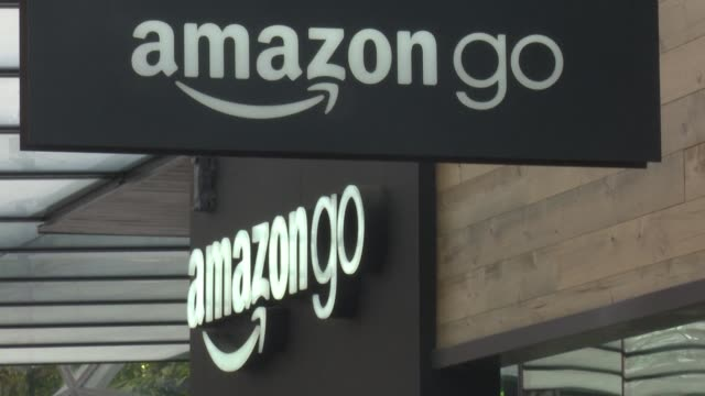 online giant amazon opens a convenience store in seattle where hungry customers are able to grab sandwiches and go without having to wait in line or... - sandwich stock videos & royalty-free footage