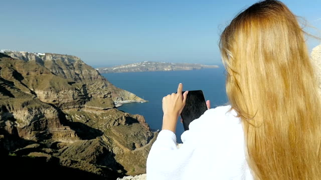 online in the morning in santorini - health spa stock videos & royalty-free footage
