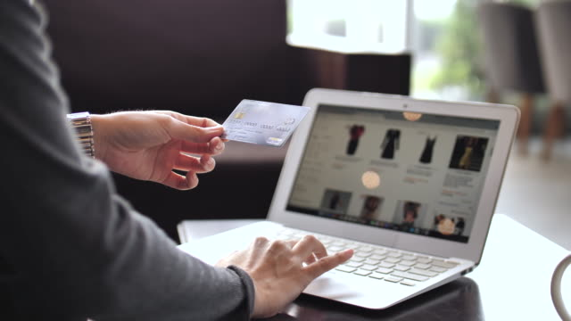 online shopping with credit card on laptop - expense stock videos & royalty-free footage